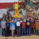 "Toys ""R"" Us and Geoffrey read to Michigamme students"